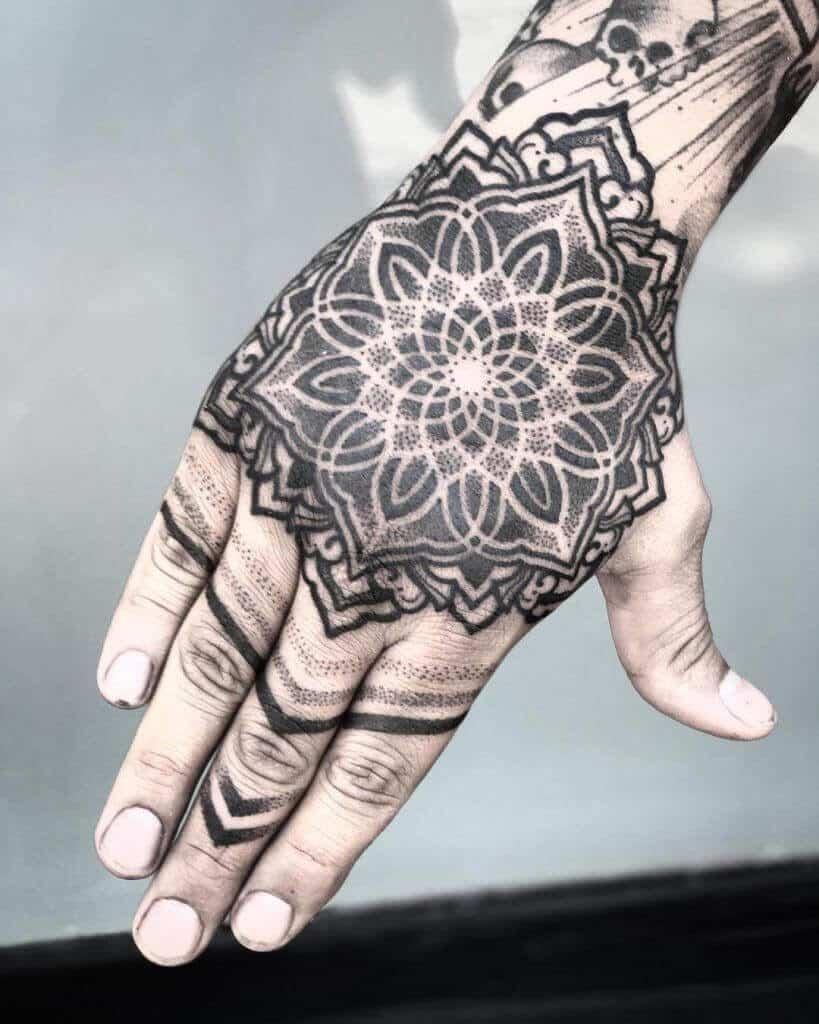 pointillism tattoo on hand