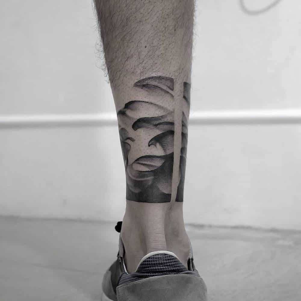 pointillism leg tattoo