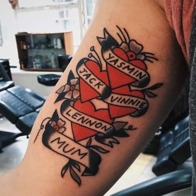 sailor jerry heart tattoo on arm