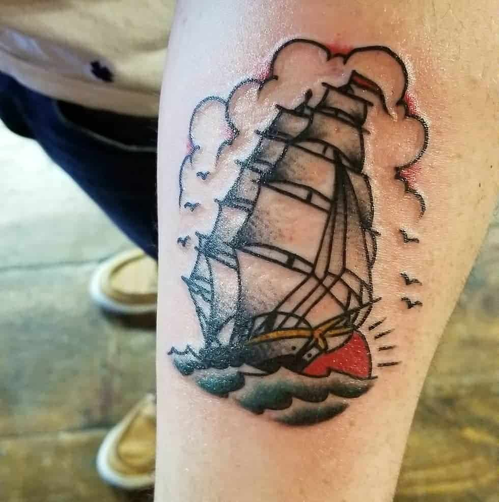 sailor jerry ship tattoo on arm