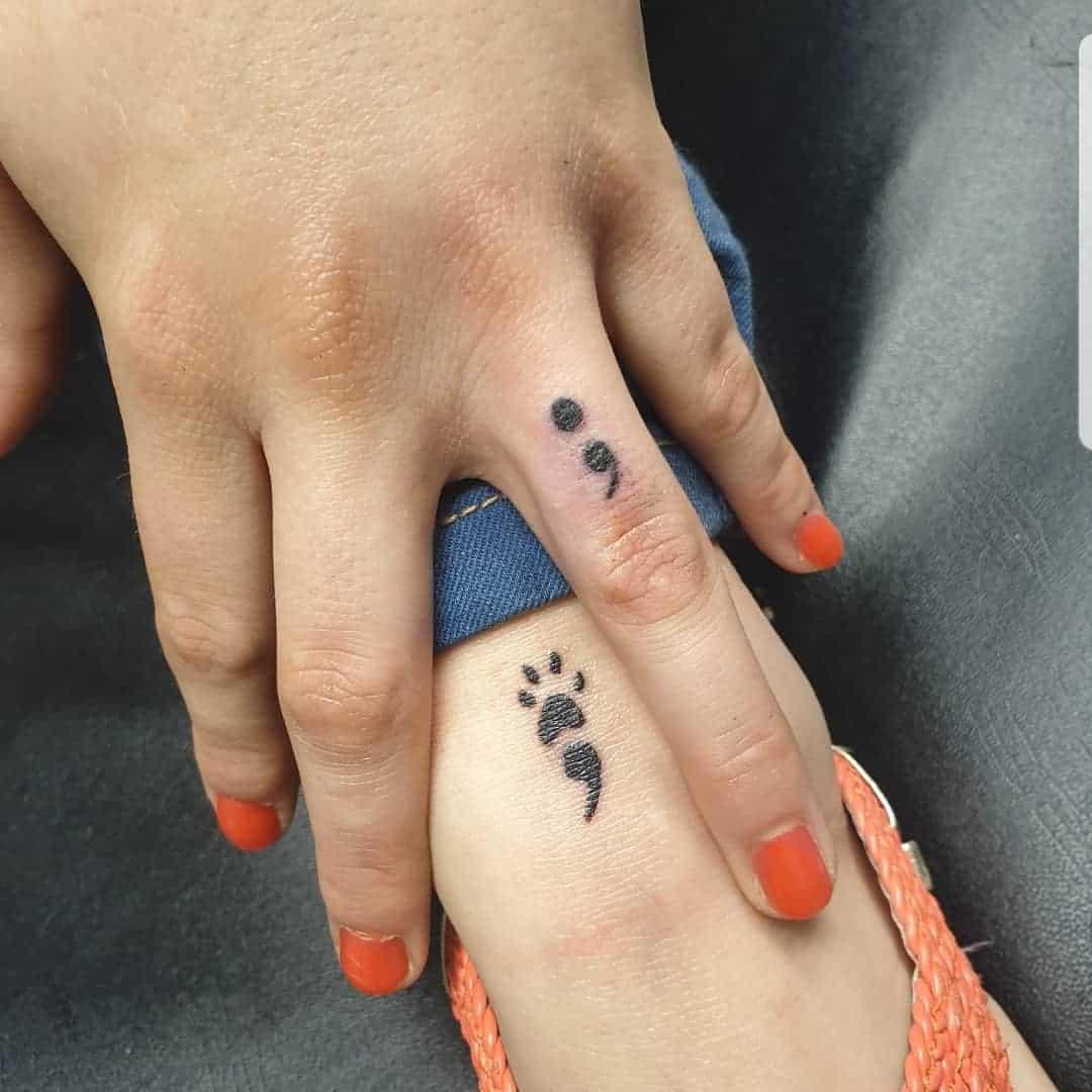 semicolon finger tattoo