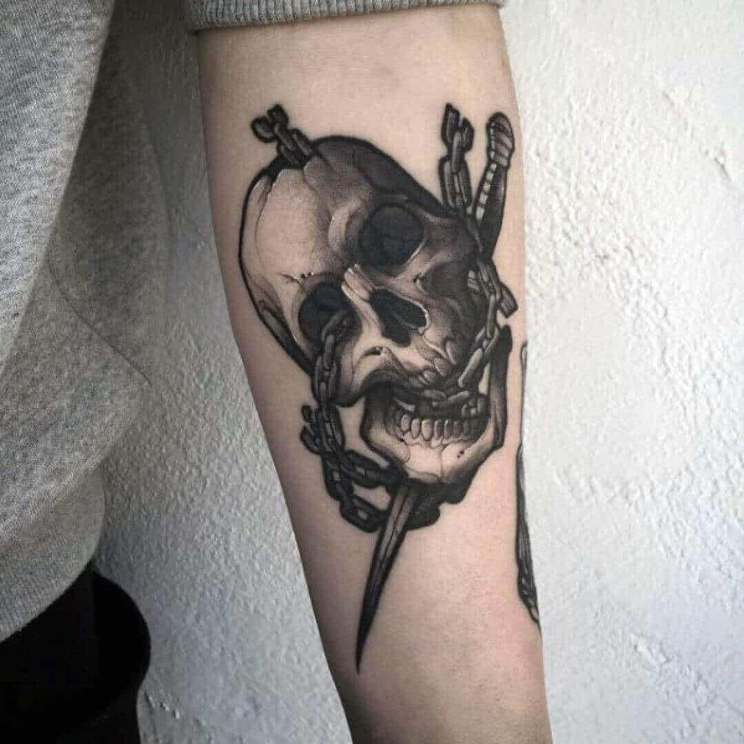 skull and dagger tattoo