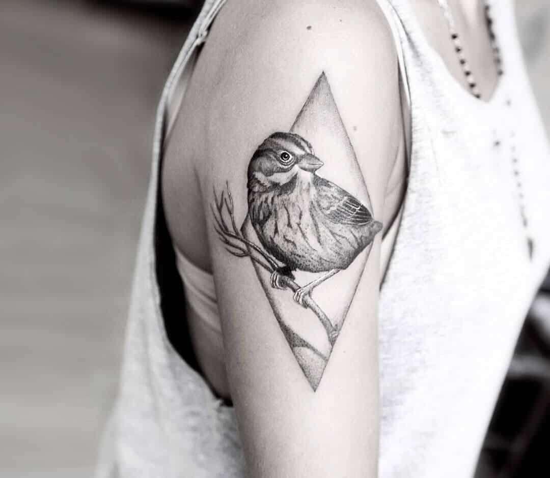 sparrow tattoo on arm