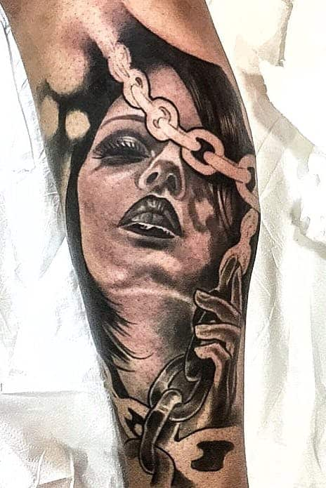 surrealism arm tattoo