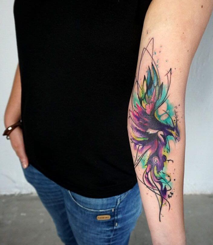 watercolor arm tattoo
