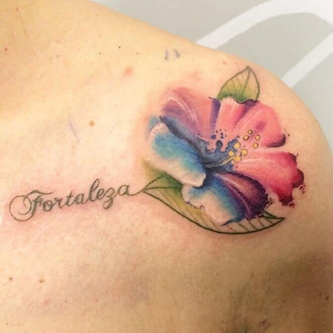 watercolor hibiscus tattoo on shoulder