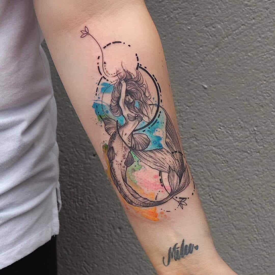 watercolor mermaid tattoo on arm