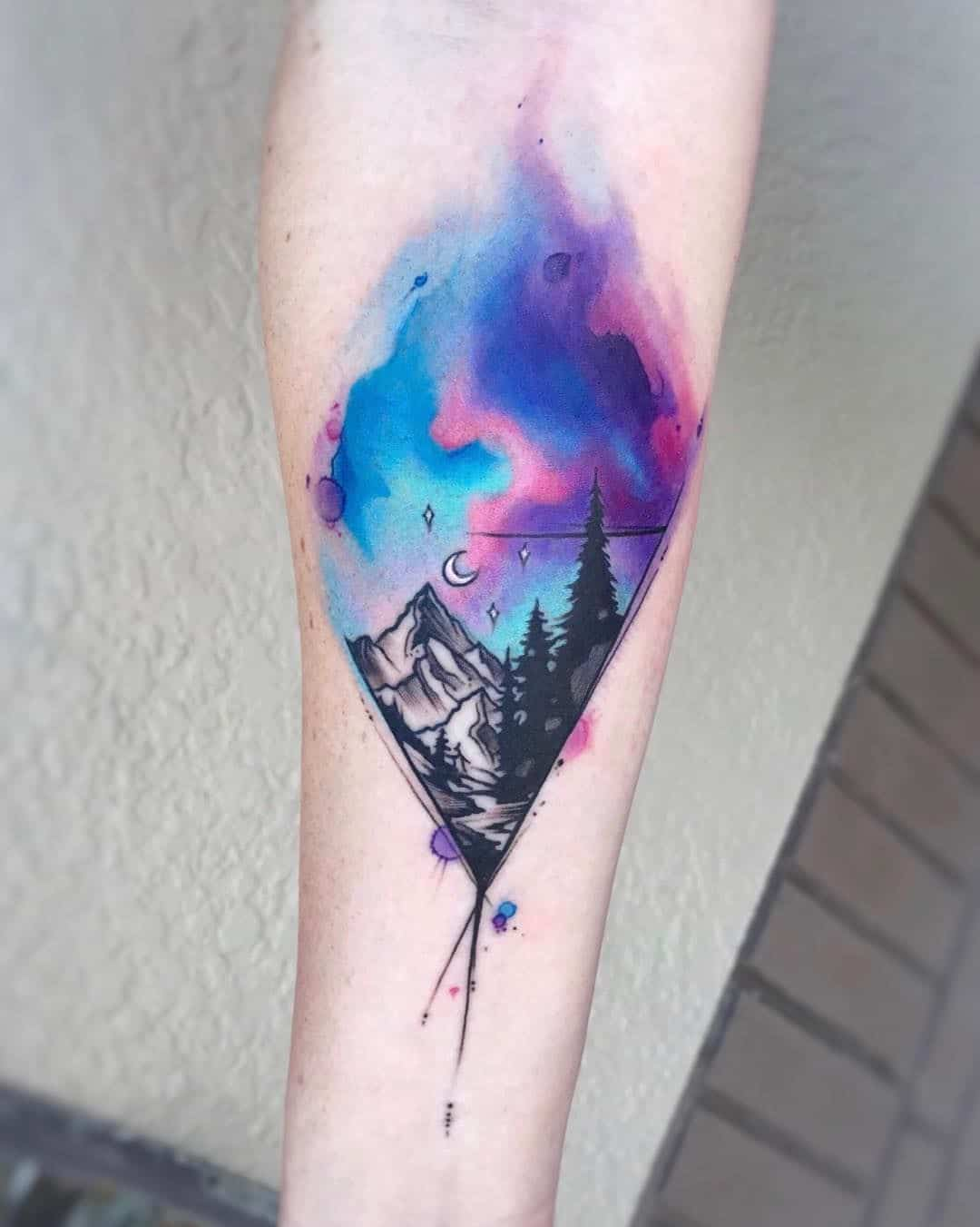 watercolor mountain tattoo on arm