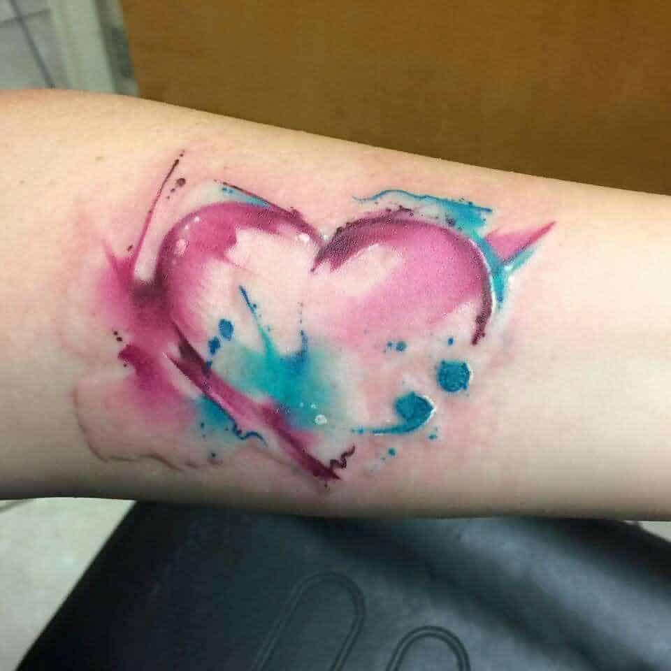 watercolor semicolon tattoo on arm