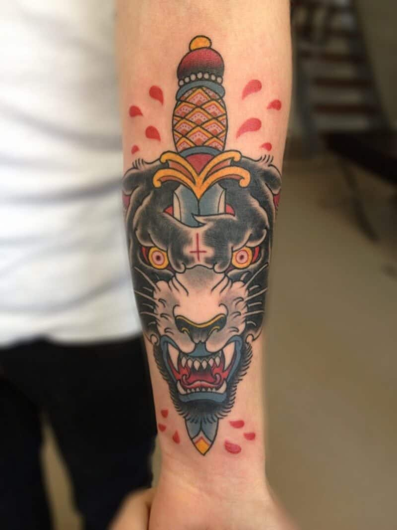 wolf and dagger tattoo