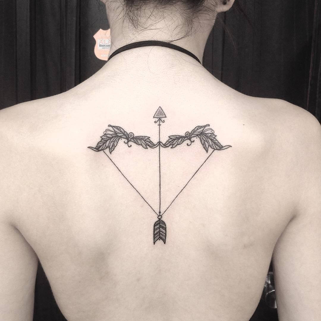 arrow sagittarius tattoo on back