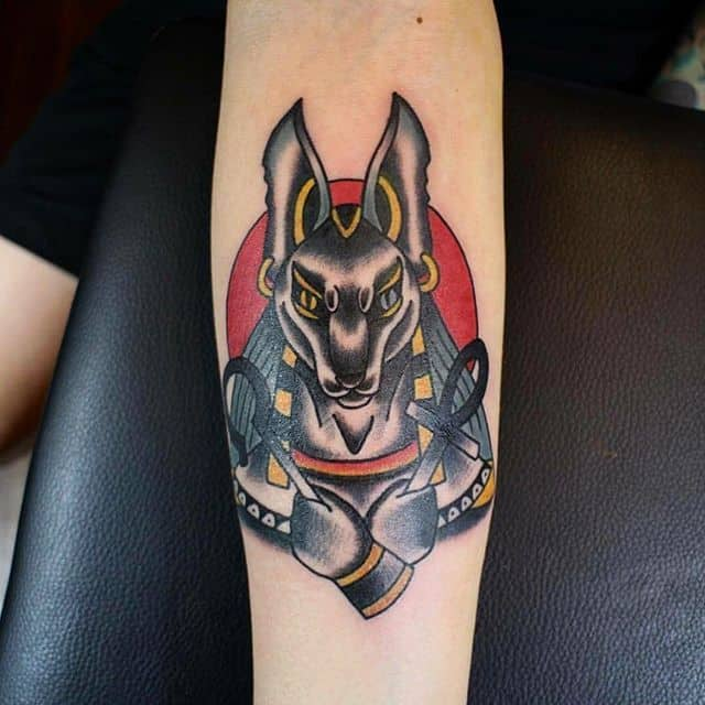 colored anubis tattoo on arm