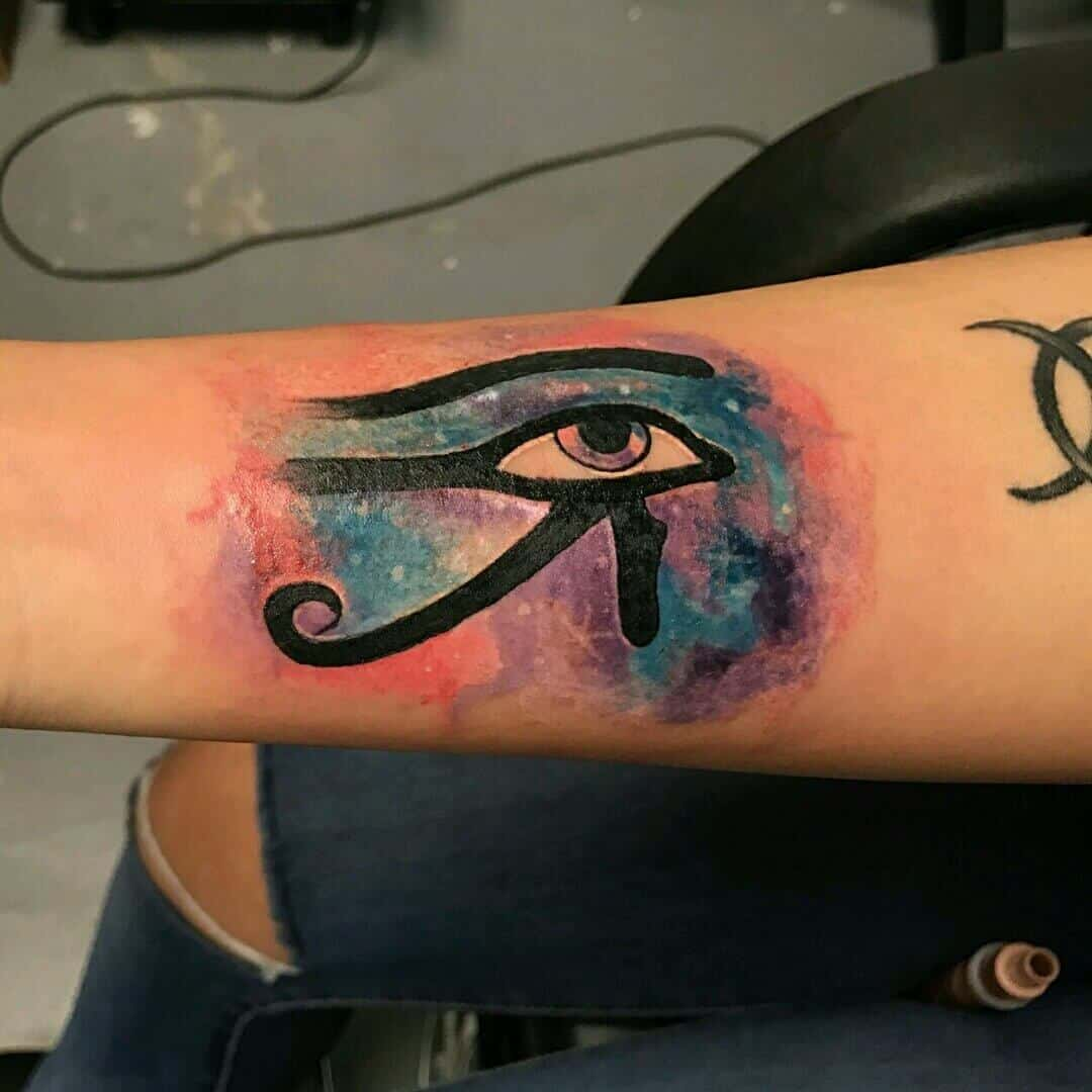 colored eye of horus tattoo on arm