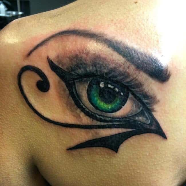 colored eye of horus tattoo on back