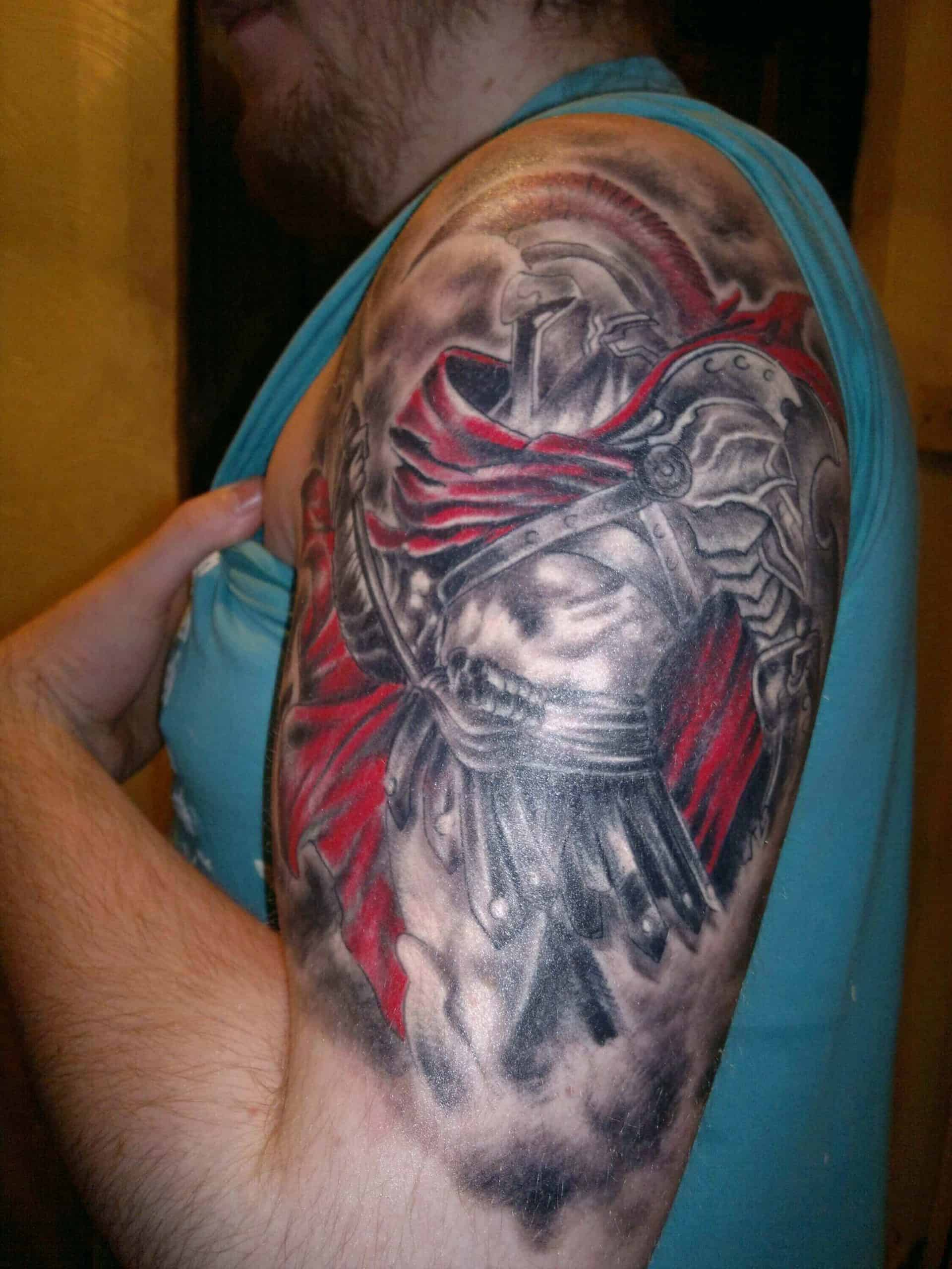 colored god of war tattoo on arm