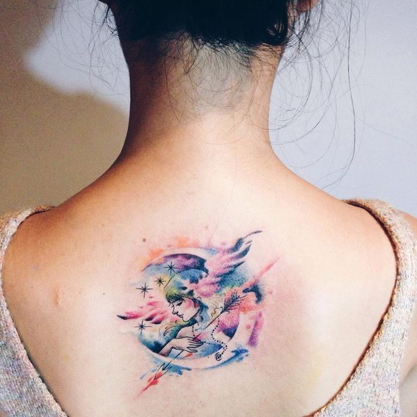 colored sagittarius tattoo on back