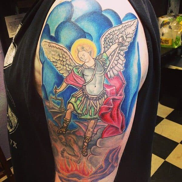 colored saint michael tattoo on arm