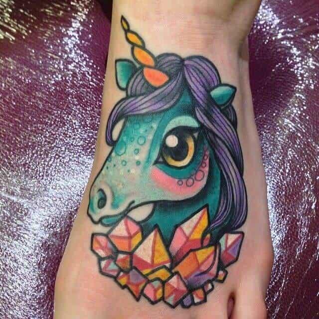 colorful unicorn tattoo on foot