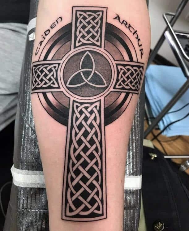cross celtic tattoo on arm
