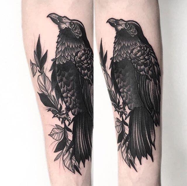 crow raven arm tattoo