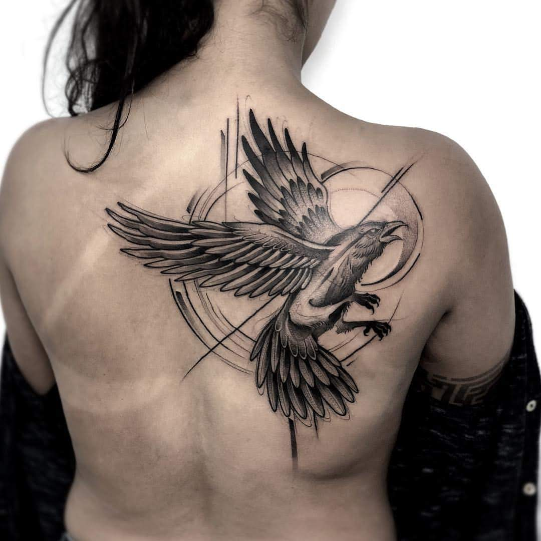 crow raven back tattoo