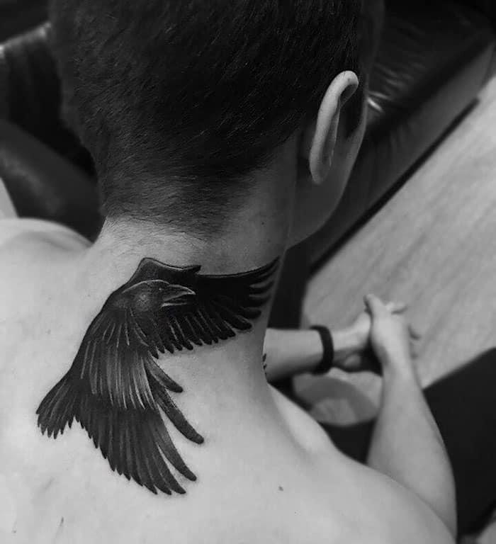 crow raven neck tattoo