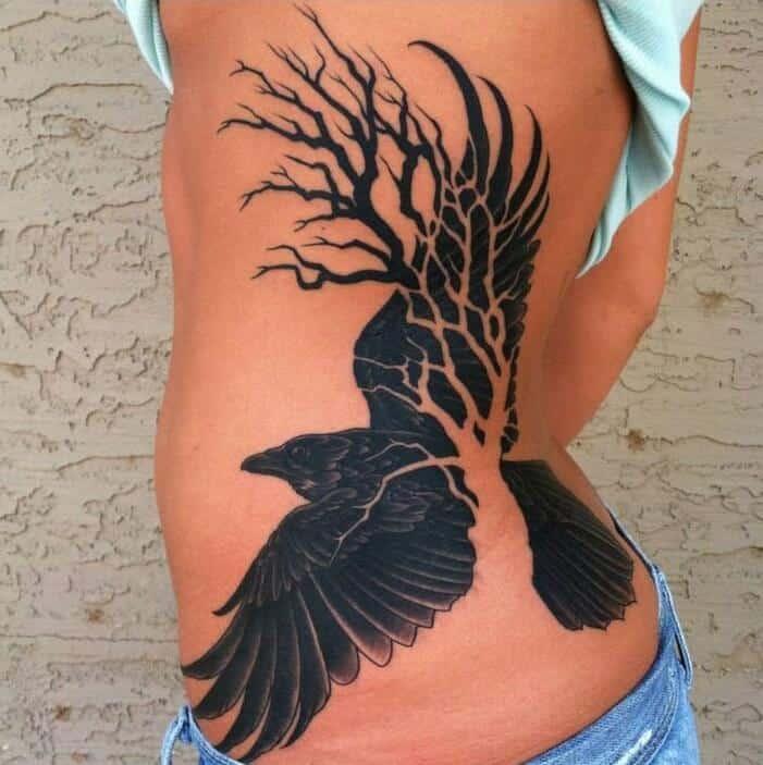 crow raven rib tattoo