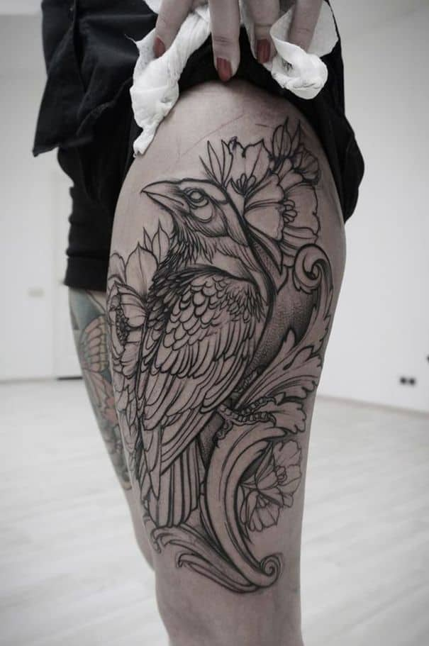 crow raven thigh tattoo