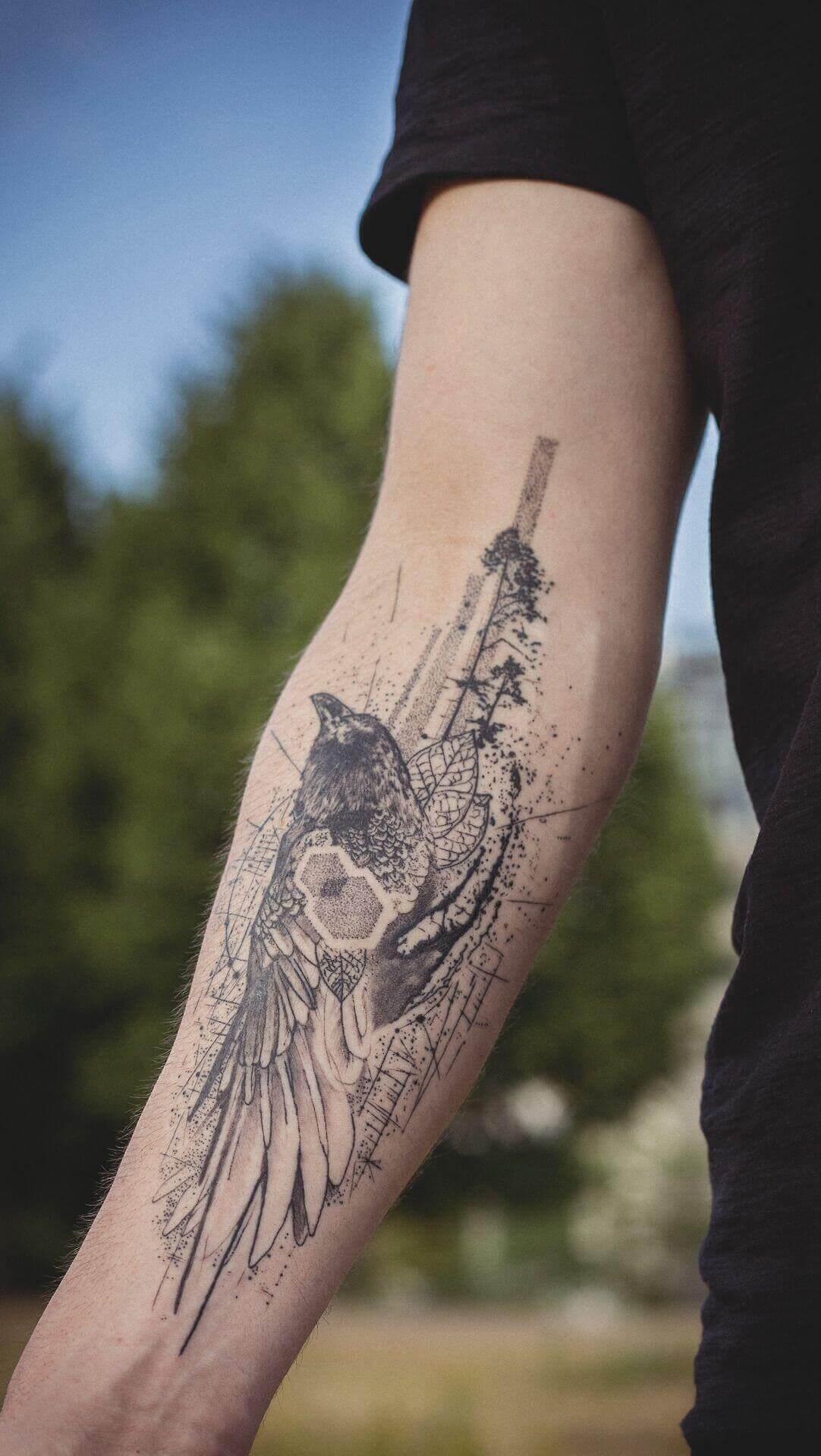 geometric crow raven tattoo