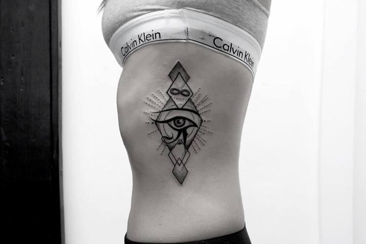 geometric eye of horus tattoo on rib