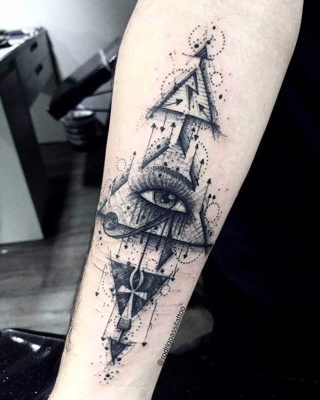 geometric eye of horus tattoo on arm