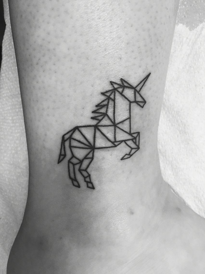 geometric unicorn tattoo on ankle