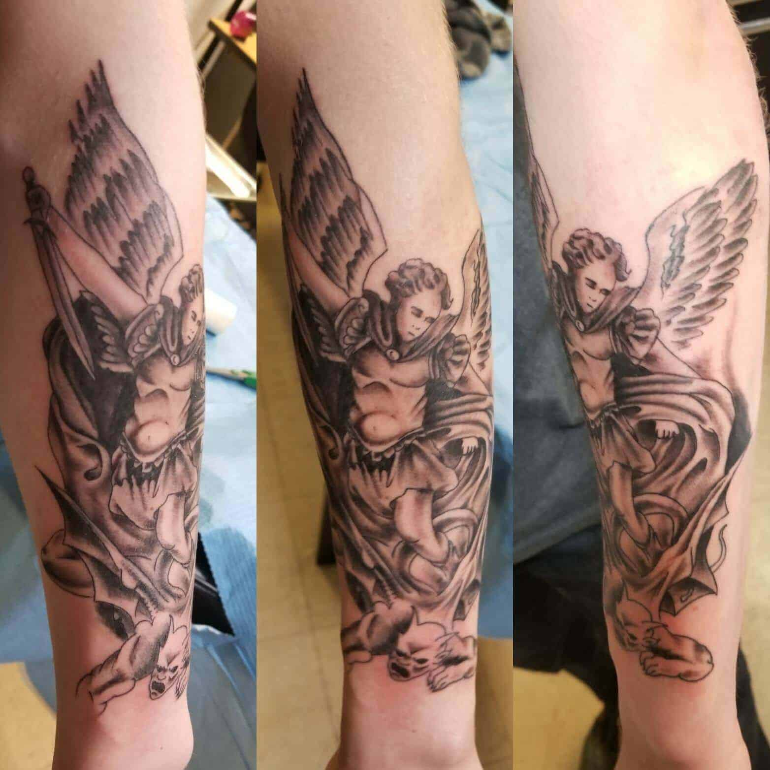 saint michael arm tattoo