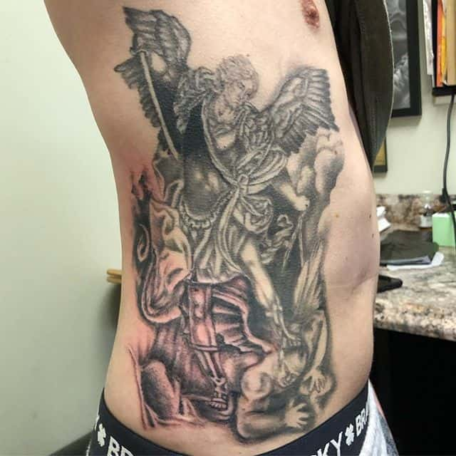 saint michael tattoo on rib