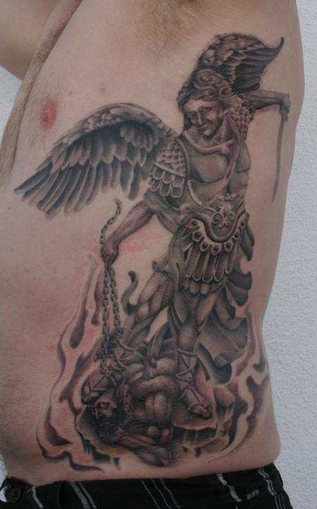 saint michael rib tattoo