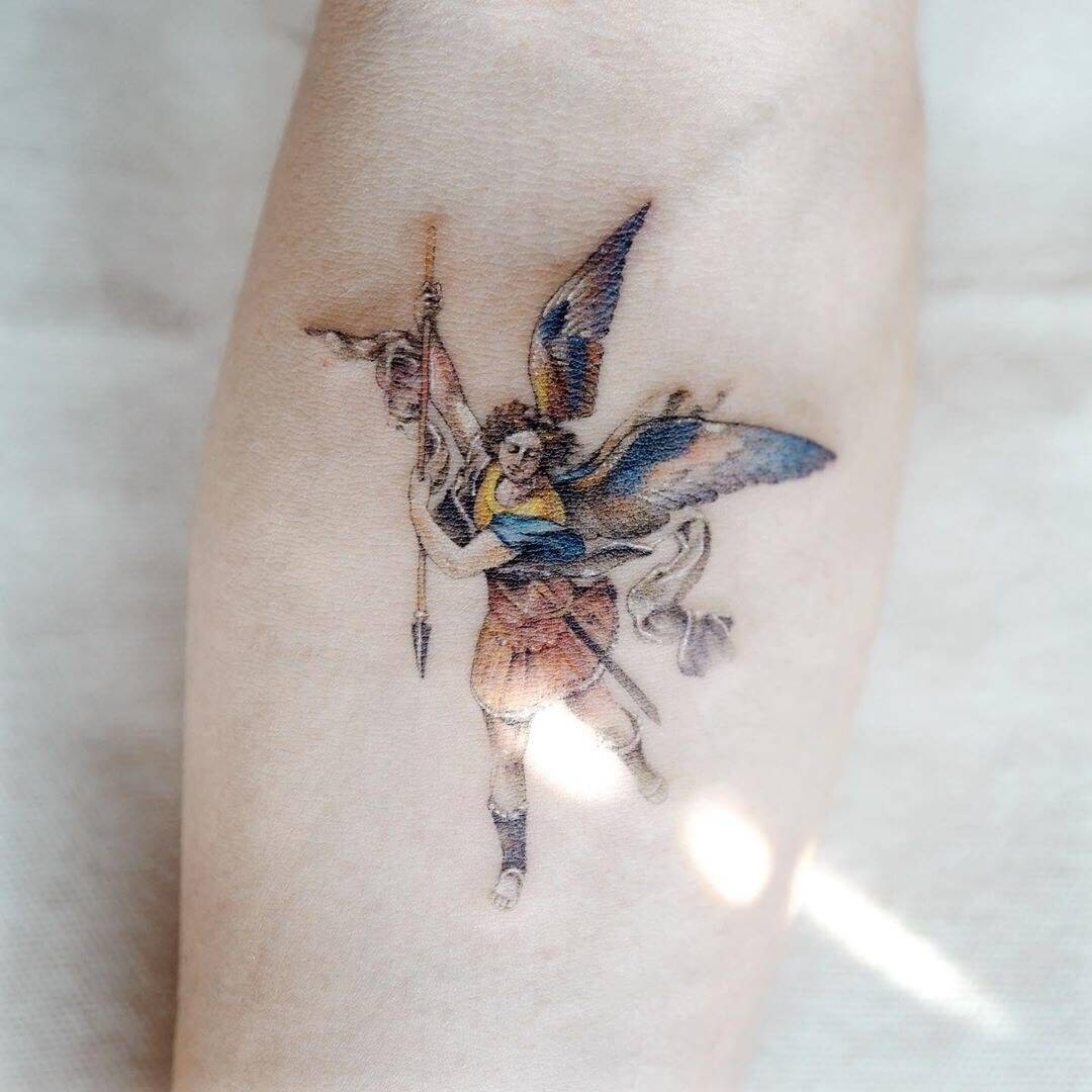 small saint michael tattoo on arm