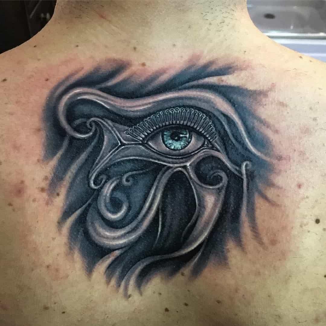 tribal eye of horus tattoo on back