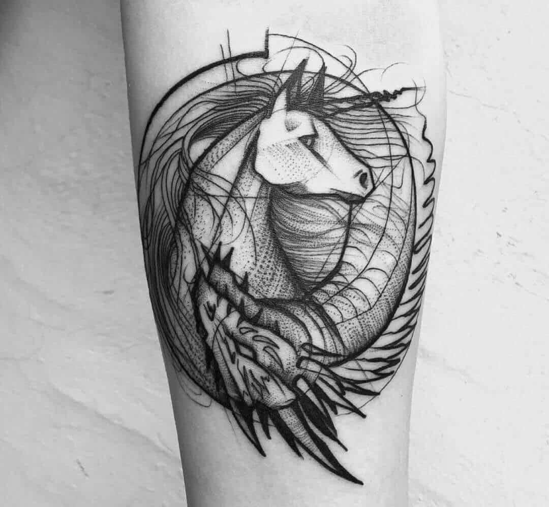 unicorn arm tattoo