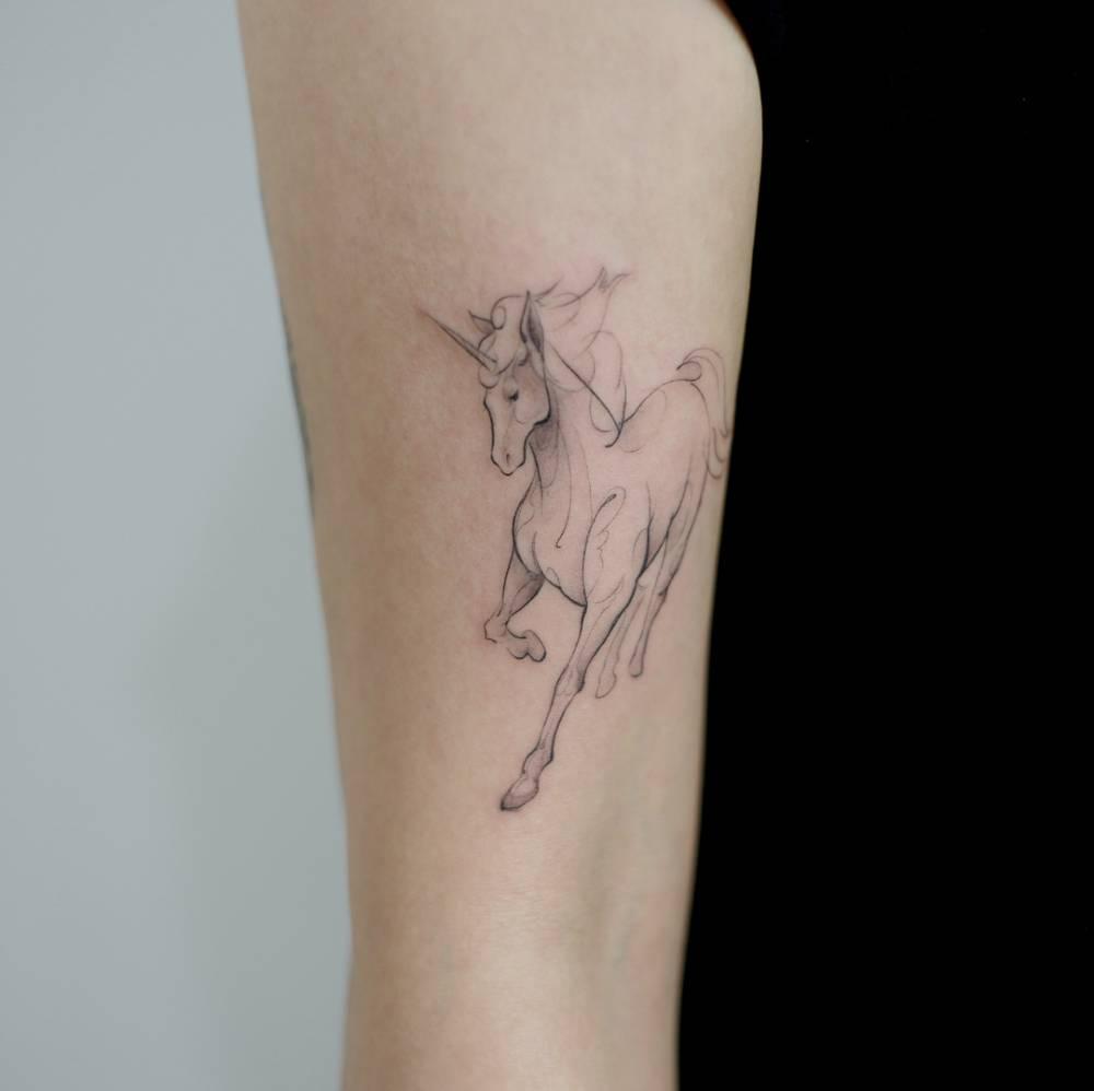 unicorn tattoo on arm