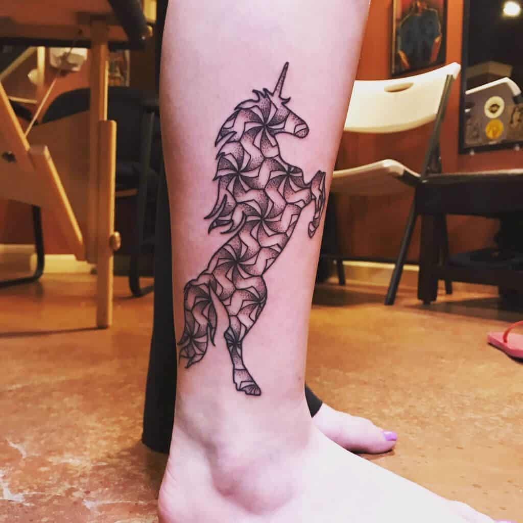 unicorn tattoo on leg