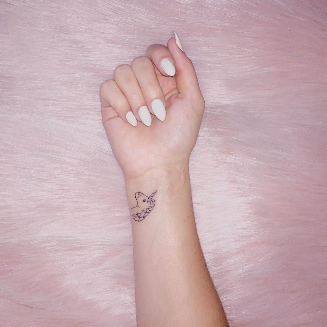 unicorn tattoo on wrist