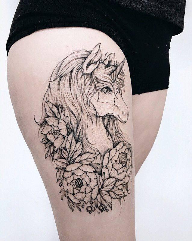 unicorn tattoo on thigh