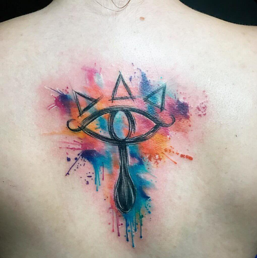 watercolor egyptian tattoo on back