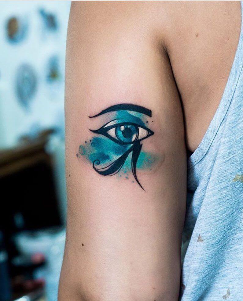 watercolor eye of horus tattoo on arm