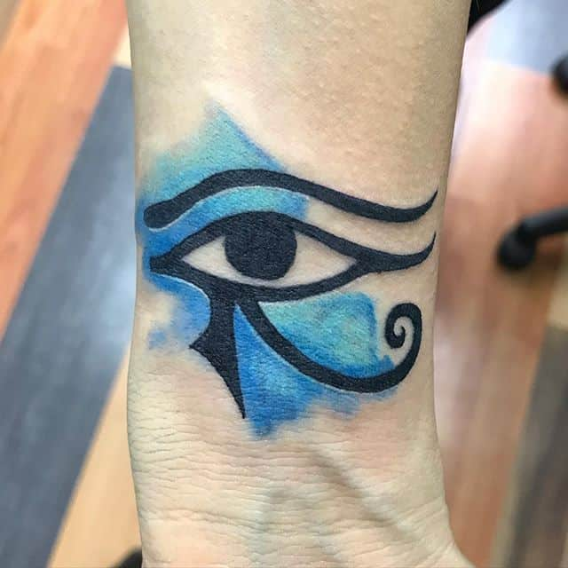 tribal eye of horus tattoo on neck