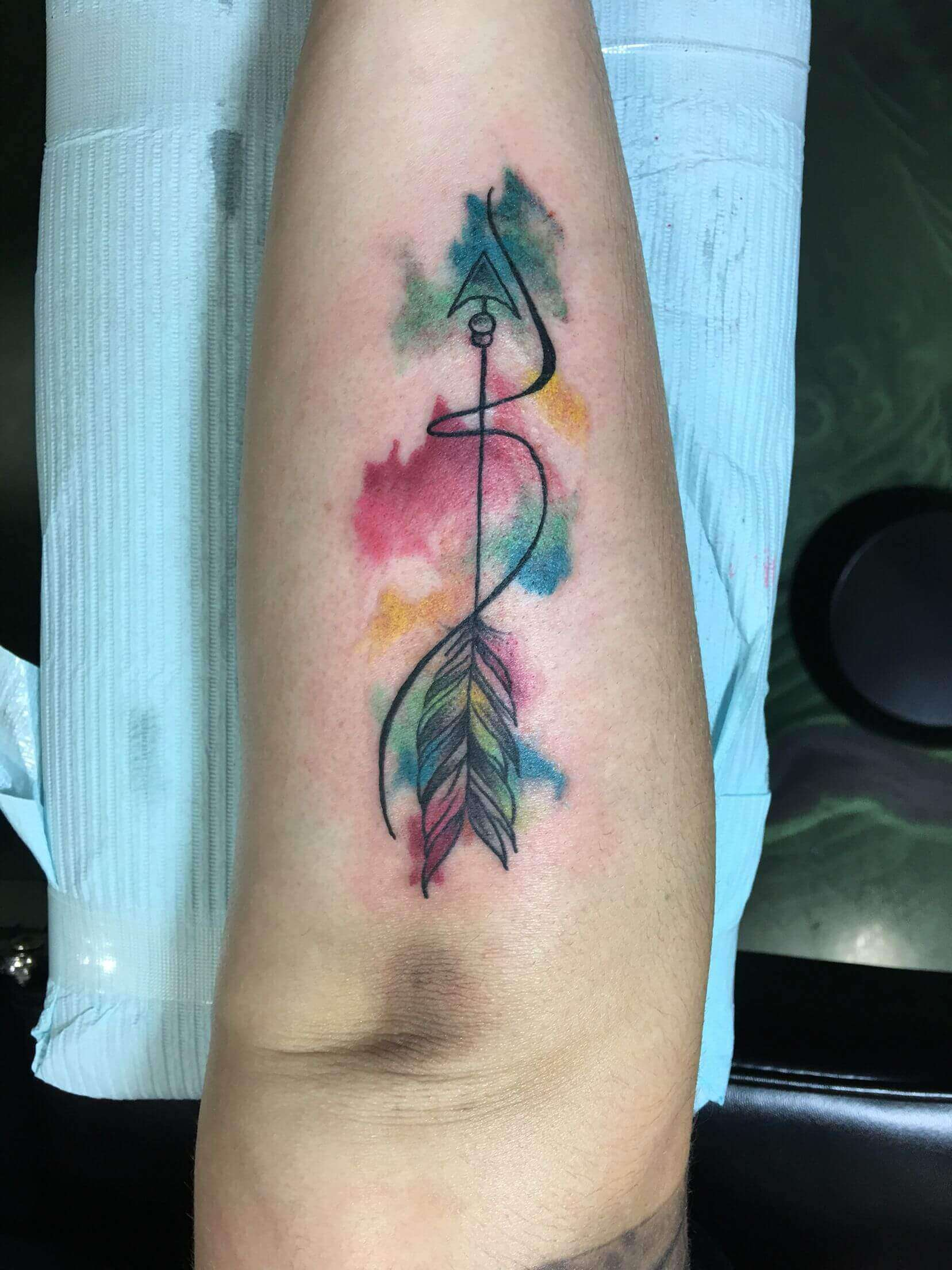 watercolor sagittarius tattoo on arm