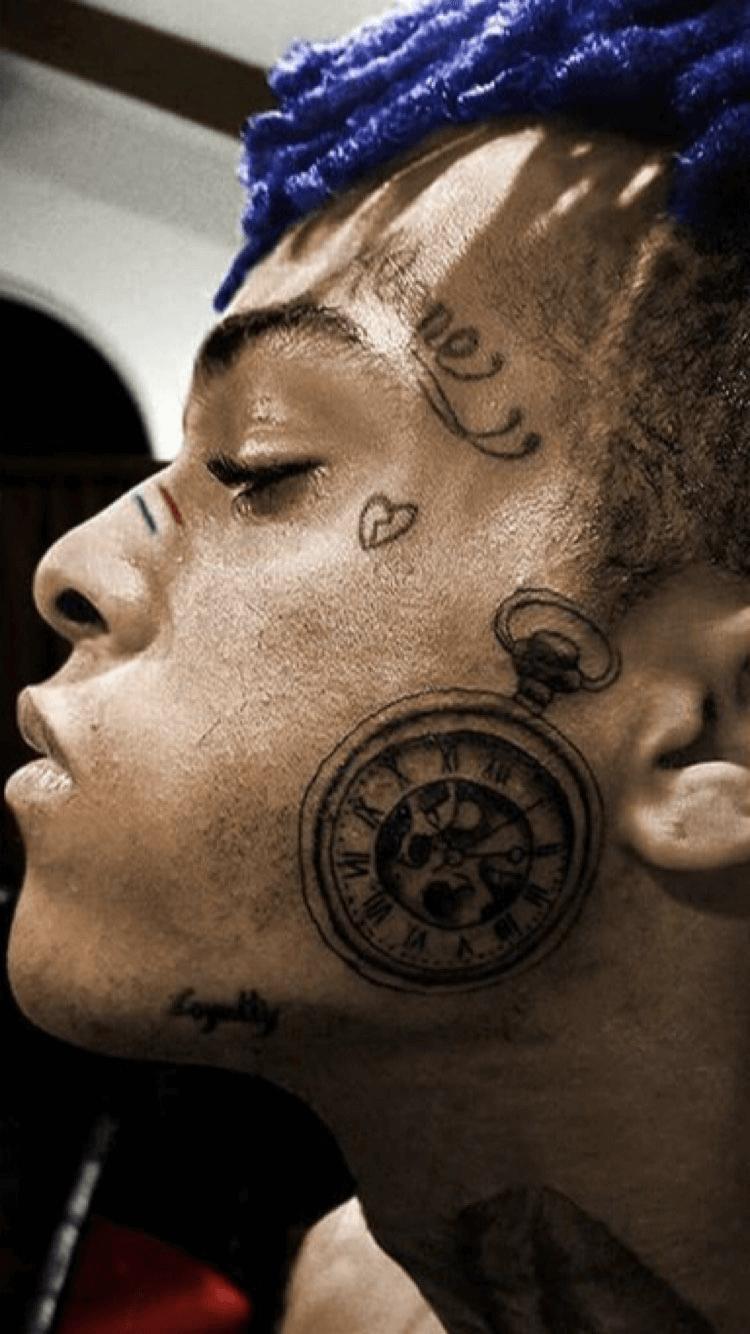 XXXTentacion clock tattoo