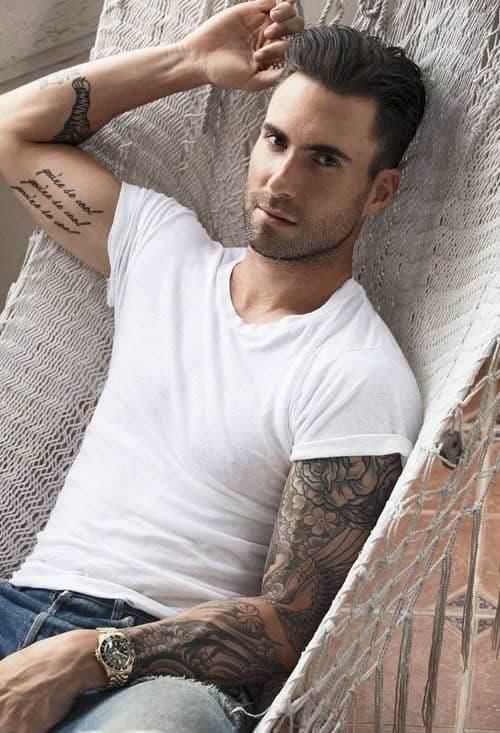 adam levine cursive tattoo