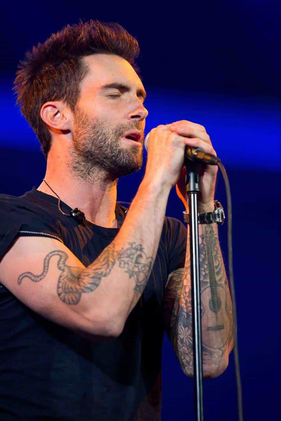 adam levine guitar tattoo