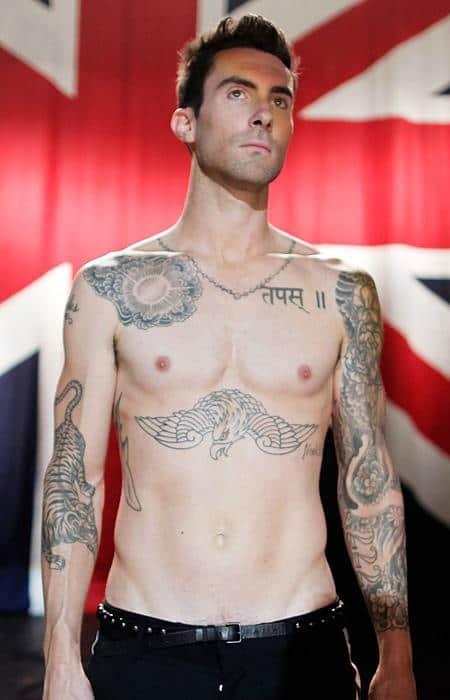 adam levine sun and flower tattoo